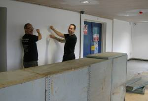 Moor's Mike Cable and Justin Hawke mime pouring beer. They'll be doing it for real once the taproom is fitted out and officially opened.